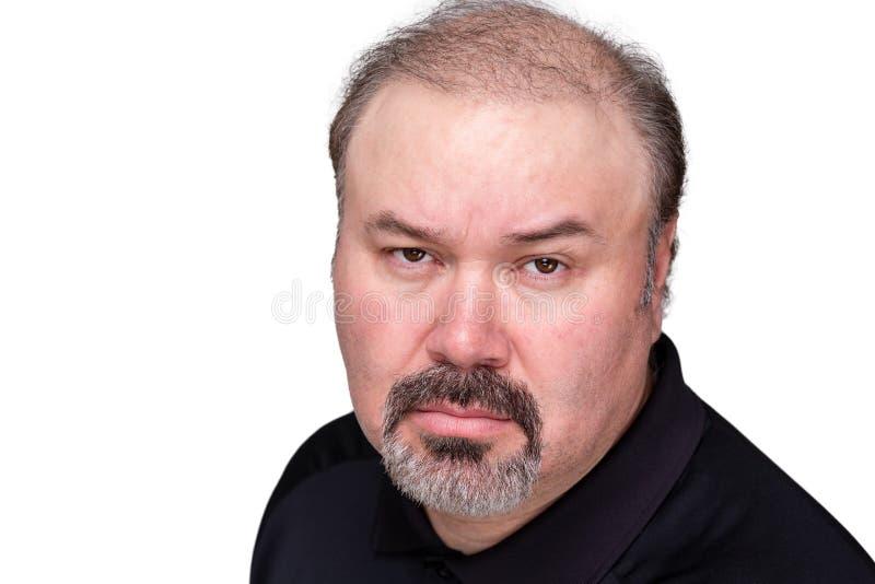 Unerbittlicher anmaßender Mann von mittlerem Alter lizenzfreie stockfotos