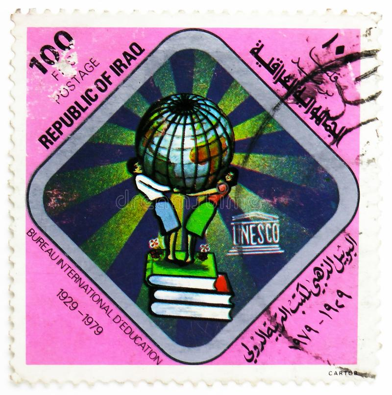 UNESCO and BIE emblem, 50 years International Bureau of Education serie, circa 1979. MOSCOW, RUSSIA - JULY 25, 2019: Postage stamp printed in Iraq shows UNESCO stock photos
