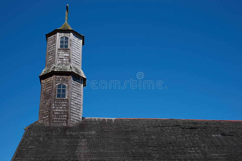 UNESCO Historic Church. Tower of historic wooden church, Iglesia de Colo, built in the 17th century by Jesuit missionaries on the island of Chiloe in Chile royalty free stock photo