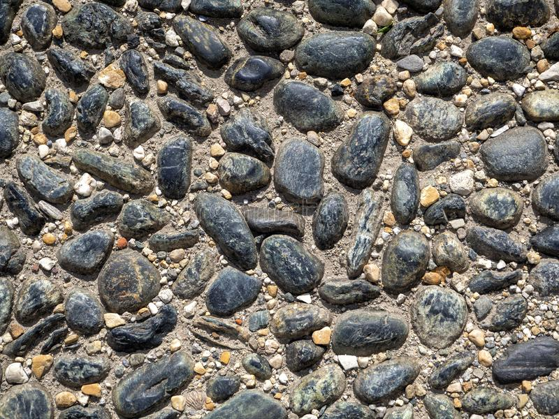 The uneven surface of the cobblestone pavement royalty free stock photo