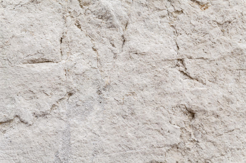 Uneven Surface Texture Of An Ancient Square Stone royalty free stock photo