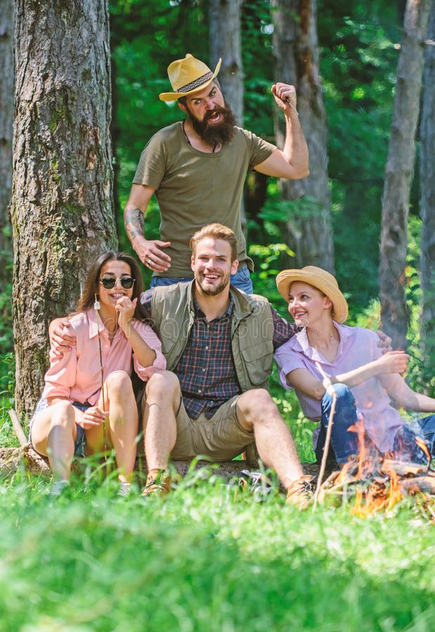 Unexpectable danger. Man brutal thief holds knife going attack hikers in forest. Friends relaxing and not expect to be royalty free stock image
