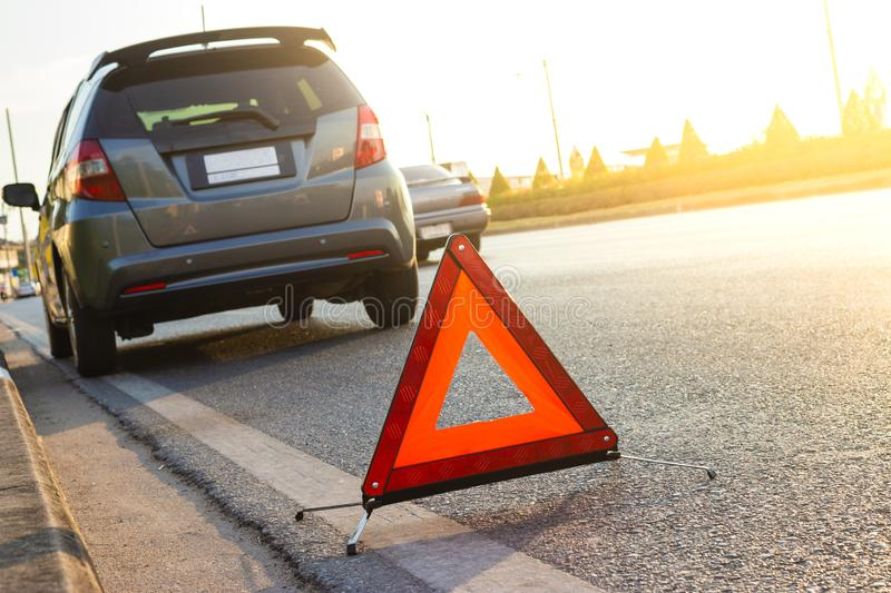 Unexpected situation, Emergency stop sign and broken city car on road royalty free stock image