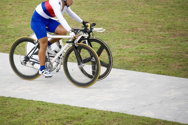 Unfair Advantage (two bicycles for one). One cyclist with two bicycles royalty free stock images