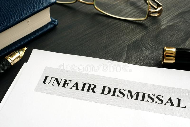 Unfair dismissal documents and pen in office royalty free stock image