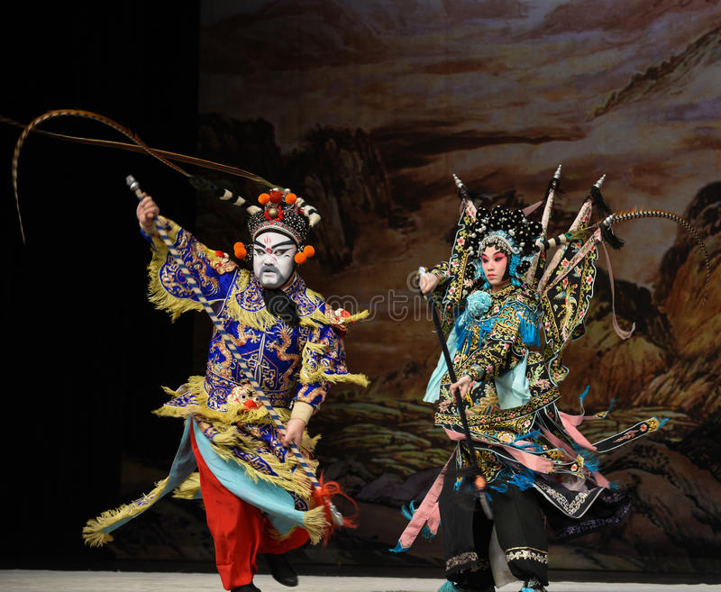 """Unfair duel- Beijing Opera"""" Women Generals of Yang Family"""". This opera tells a patriotic story how does an old woman of a hundred years old go out royalty free stock photos"""