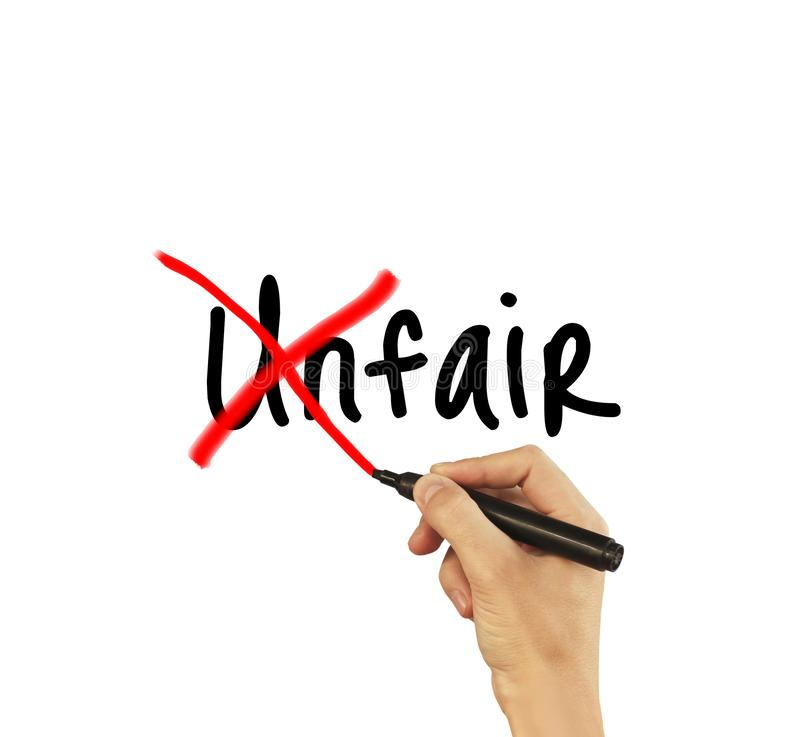 Unfair - male hand writing text on white background stock image