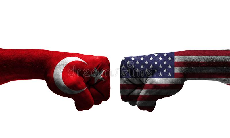 The War between 2 Countries. The unfair War between Turkey and USA countries / closed fist royalty free stock photo