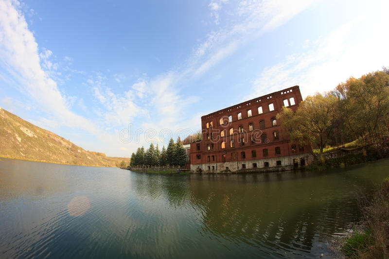 Unfinished abandoned building on the river Vorgol, Russia, fisheye effect royalty free stock image