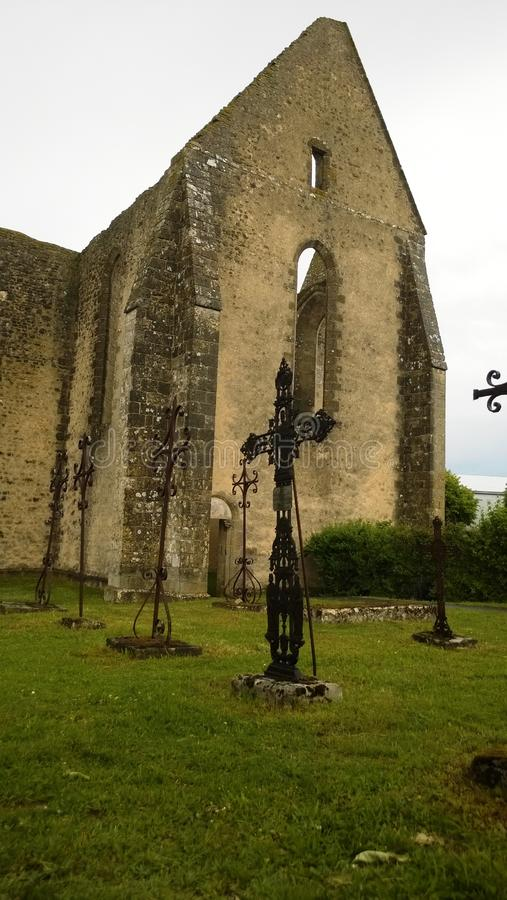 Unfinished Church of Saint Lubin and its cemetery in medieval village of Yevre chatel royalty free stock photo