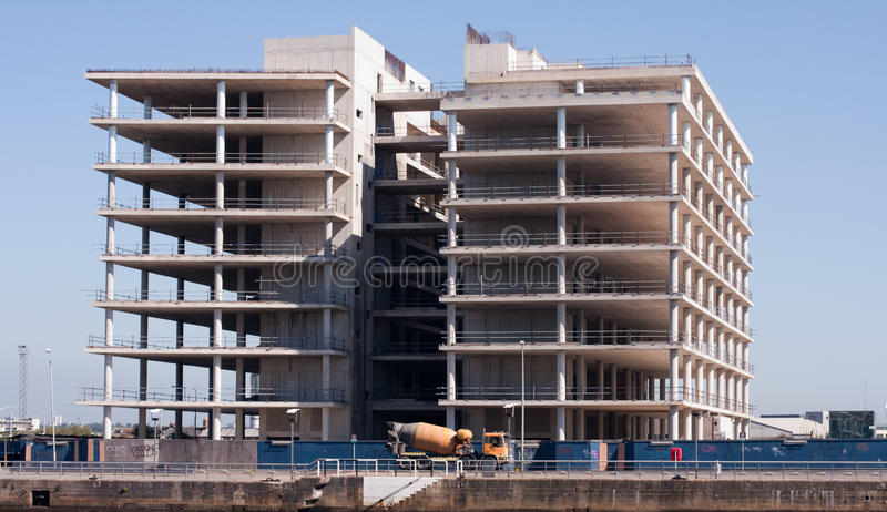 Unfinished Constraction. Low angle view at modern corporate buildings in constraction over blue sky stock photos
