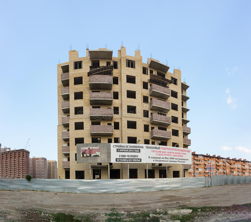 Unfinished due to the bankruptcy of the Builder multi-storey residential building on Moskovskaya street in the city of Krasnodar. KRASNODAR, RUSSIA - JULY 26 royalty free stock photos