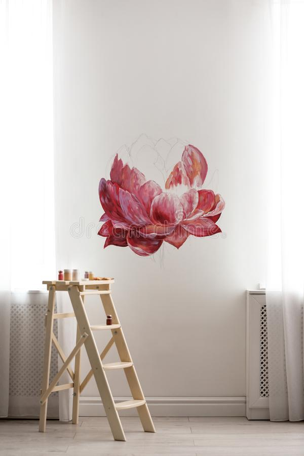 Unfinished flower painting on white wall in room royalty free stock images
