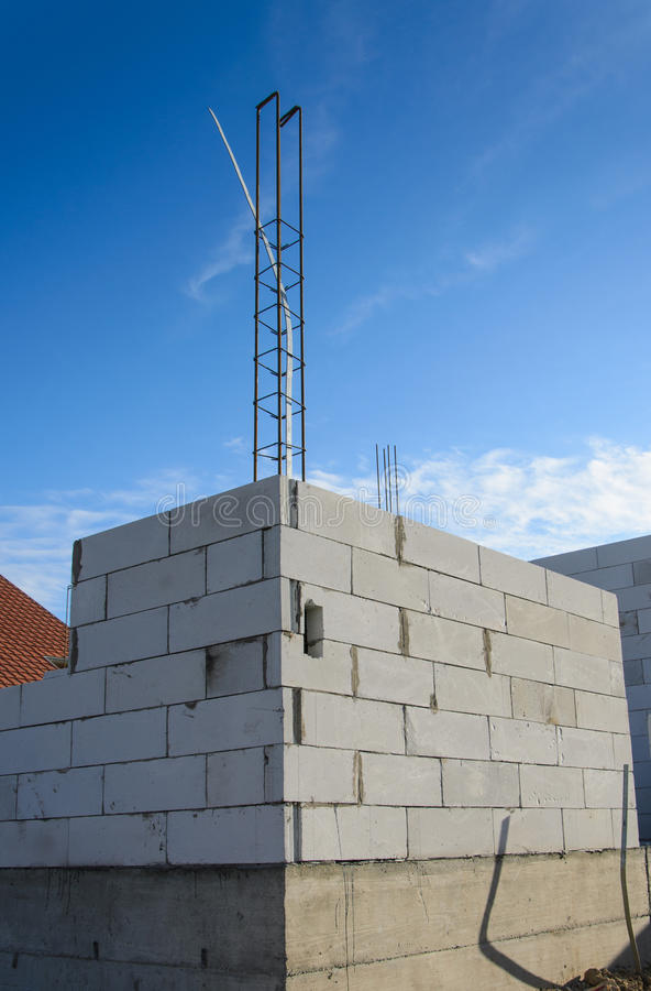 Unfinished house wall made from Aerated concrete blocks with reinforced pillar. Unfinished house wall made from Aerated concrete blocks stock photos