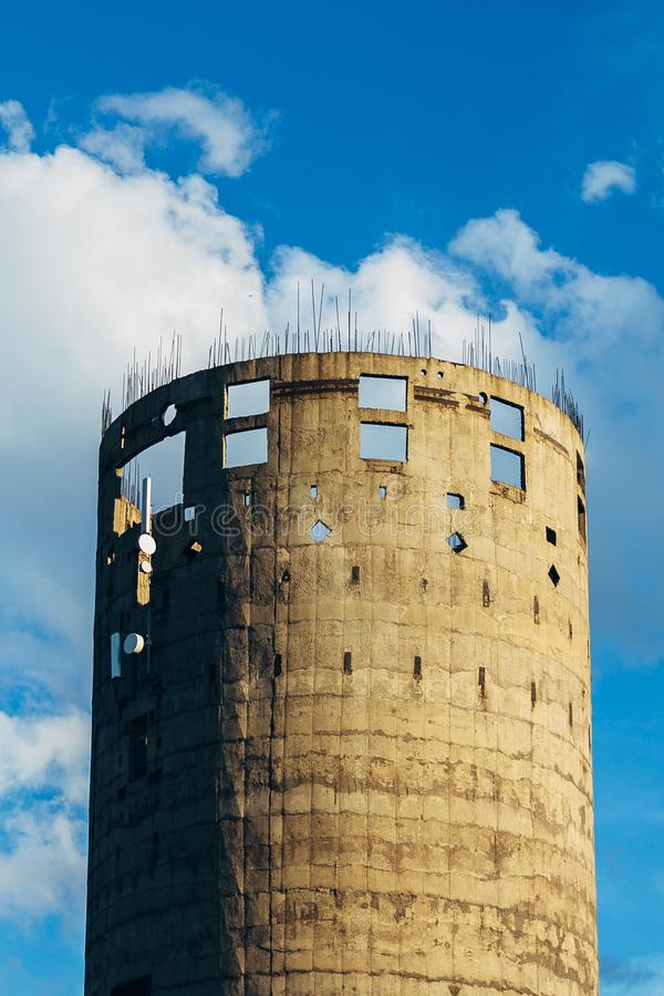 Unfinished industrial elevator. Round concrete tower with protruding pieces of reinforcement.  royalty free stock image