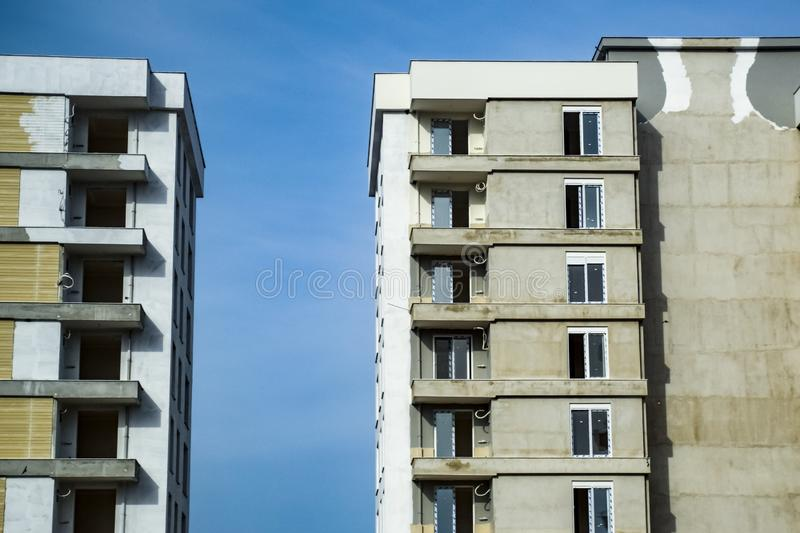 Unfinished new high rise buildings. Building against the blue sky royalty free stock photo