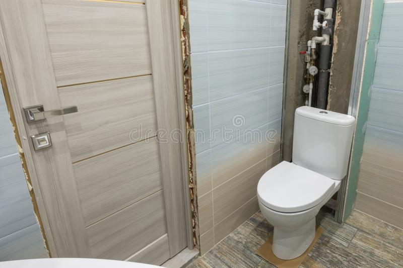 Unfinished repair in toilet stock images