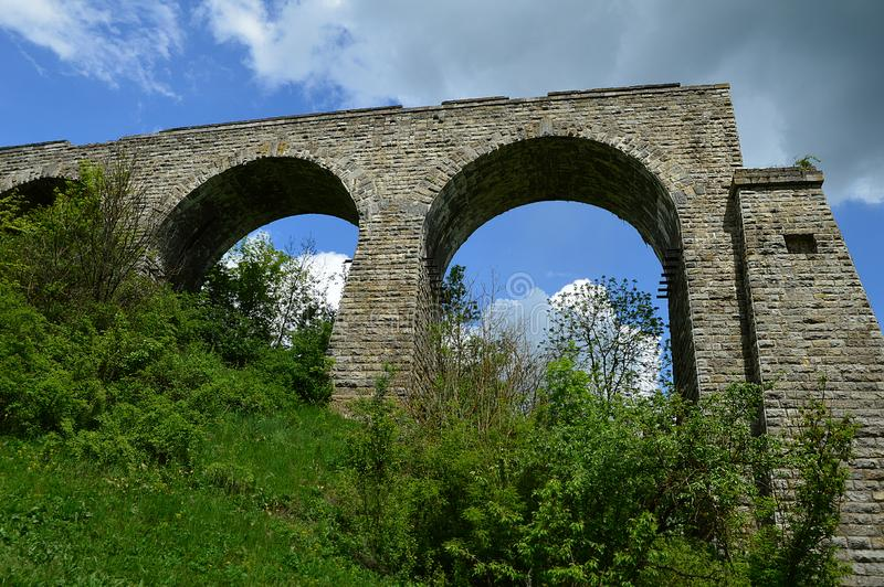Unfinished viaduct. In the village of Zubrivka near Kamyanets`-Podilskyi Ternopil region. Construction ceased in 1917 due to the war royalty free stock photography