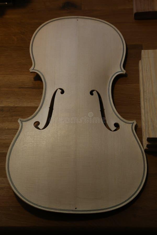 Unfinished violin in luthier, violin maker workshop. stock photo