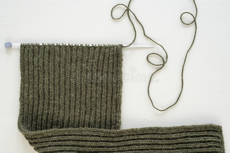 Unfinished woolen scarf on white background royalty free stock photos
