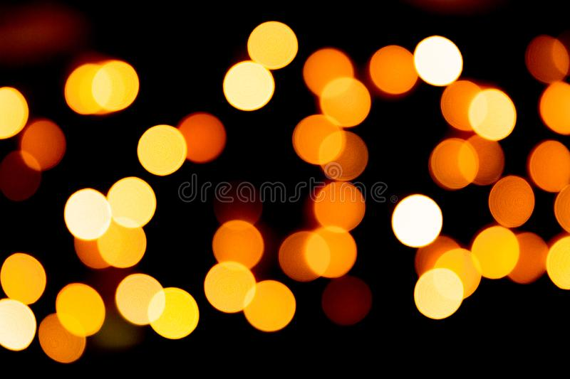 Unfocused abstract yellow bokeh on black background. defocused and blurred many round light.  vector illustration