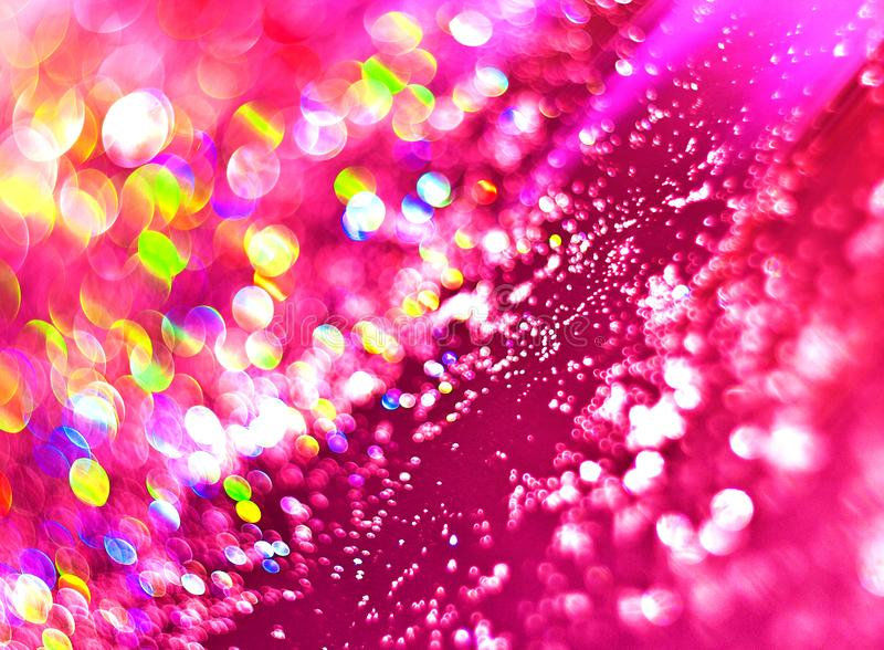 The unfocused background of shining drops of water on the pink for text, banner, poster, label, sticker, layout. royalty free stock image