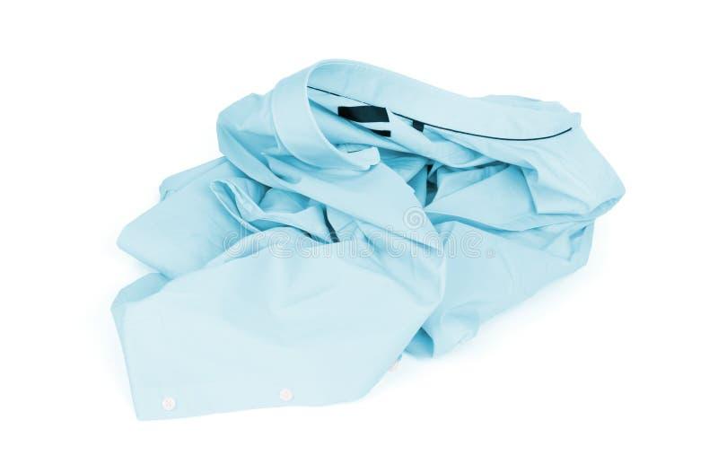 Unfolded blue man shirt on white background. Unfolded, laundry stock photography