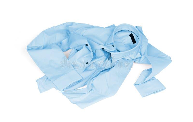 Unfolded blue man shirt on white background. Unfolded, laundry stock photos