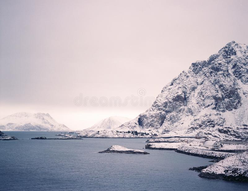 Unfrozen lake and snow mountain, winter in Norway royalty free stock photography