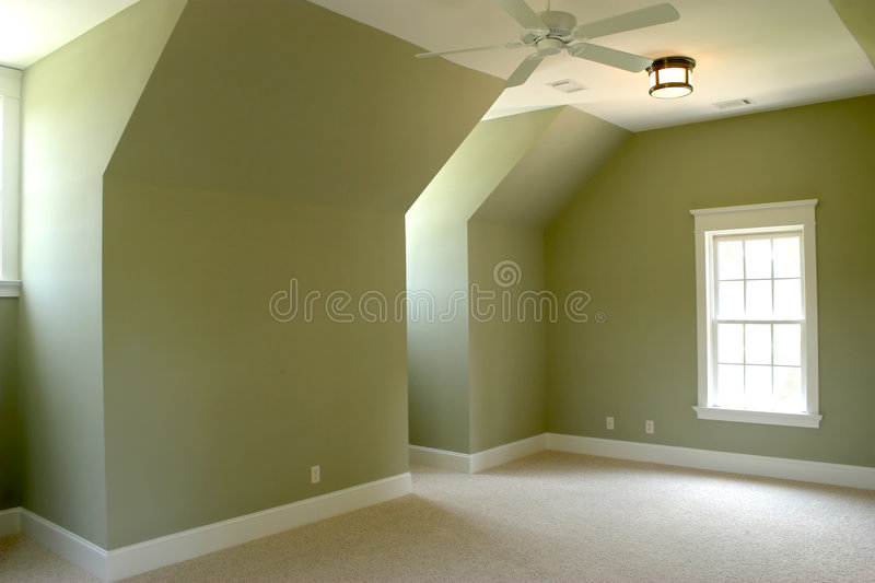 Unfurnished attic bedroom royalty free stock images