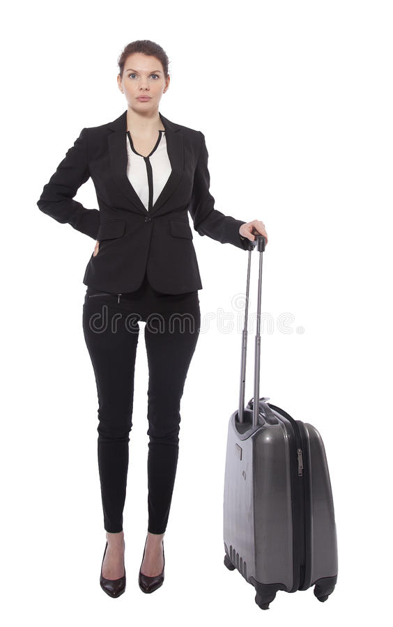 Ung affärskvinna med den isolerade resväskan royaltyfri fotografi