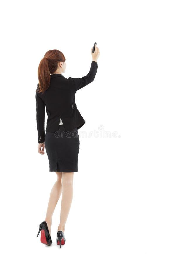 Affärskvinna som drar på vitbakgrunden arkivbild