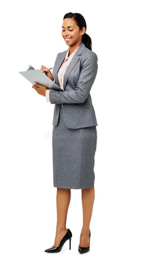 Ung affärskvinna Writing On Clipboard royaltyfri bild