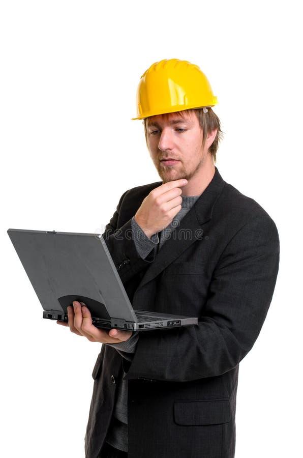 Ung affärsman med bärbar dator arkivfoto