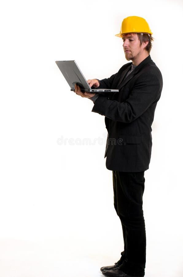 Ung affärsman med bärbar dator royaltyfri foto