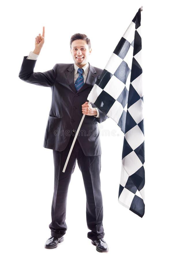 Ung affärsman och rutig flagga arkivfoto