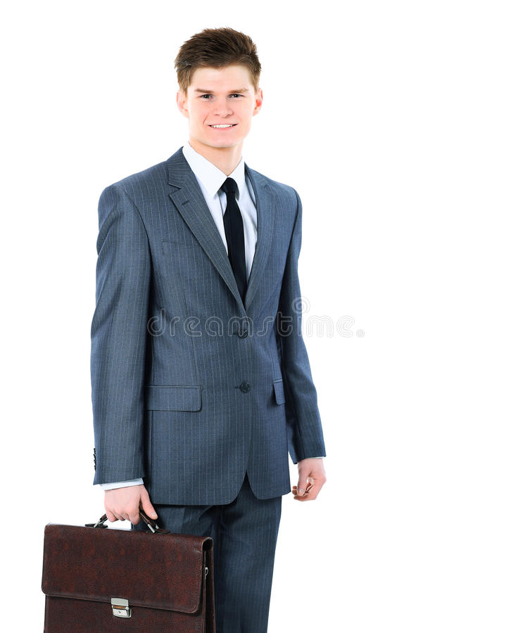 Ung affärsman på en vit bakgrund som ler med portföljen arkivfoton
