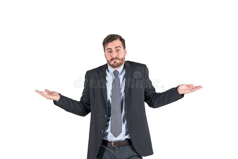 Ung affärsman som rycker på axlarna skuldror som isoleras arkivbilder