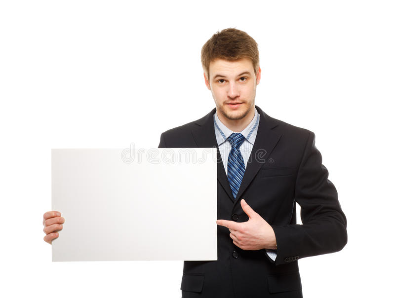 Ung affärsman som rymmer en whiteboard. Begrepp - en demonstratio arkivbild
