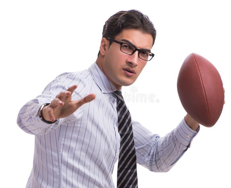 Ung aff?rsman med amerikansk fotboll som isoleras p? vit arkivbilder