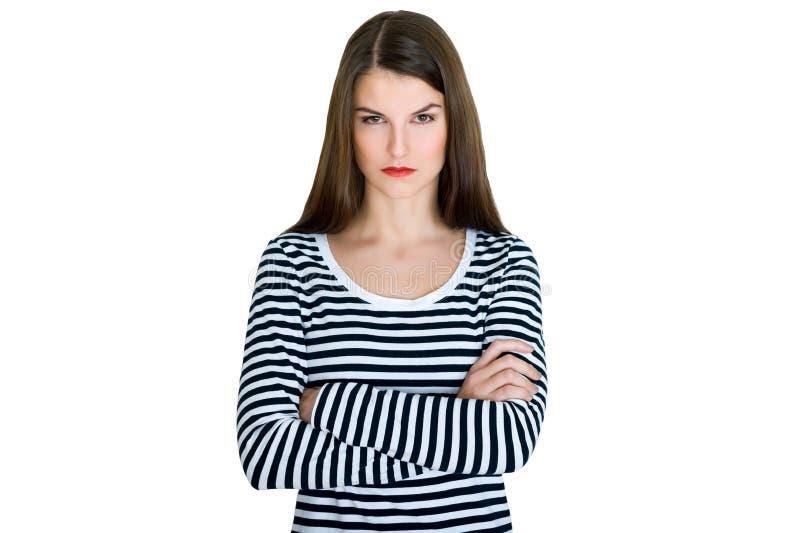 Ung allvarlig ilsken kvinnastående royaltyfria foton