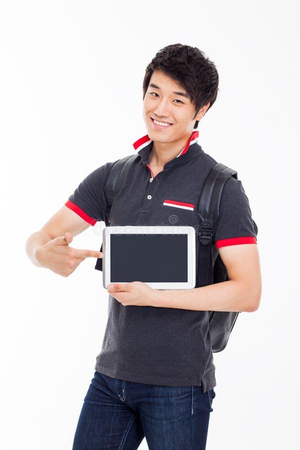 Ung asiatisk student som använder blockPC arkivfoto