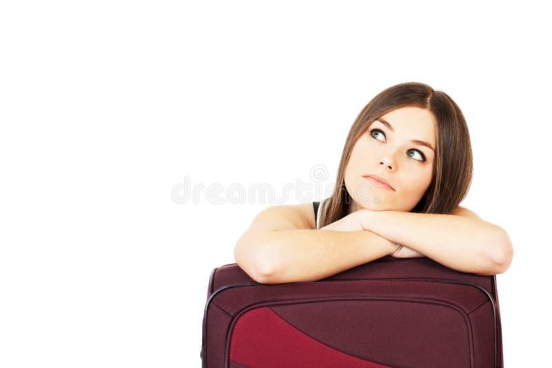 Ung attraktiv kvinna som drömmer om semester eller jorney royaltyfria bilder