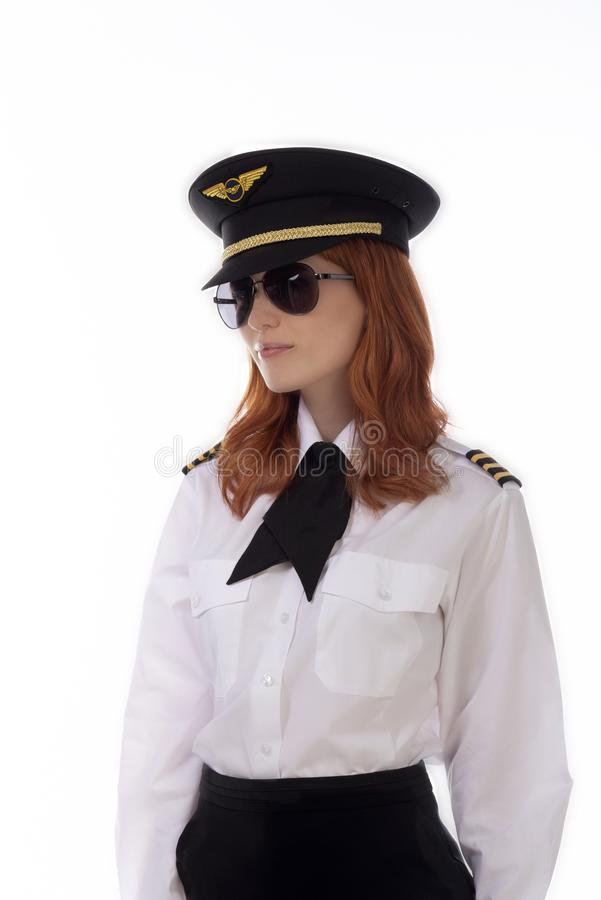 Ung attraktiv kvinnlig flygbolagpilot royaltyfri foto