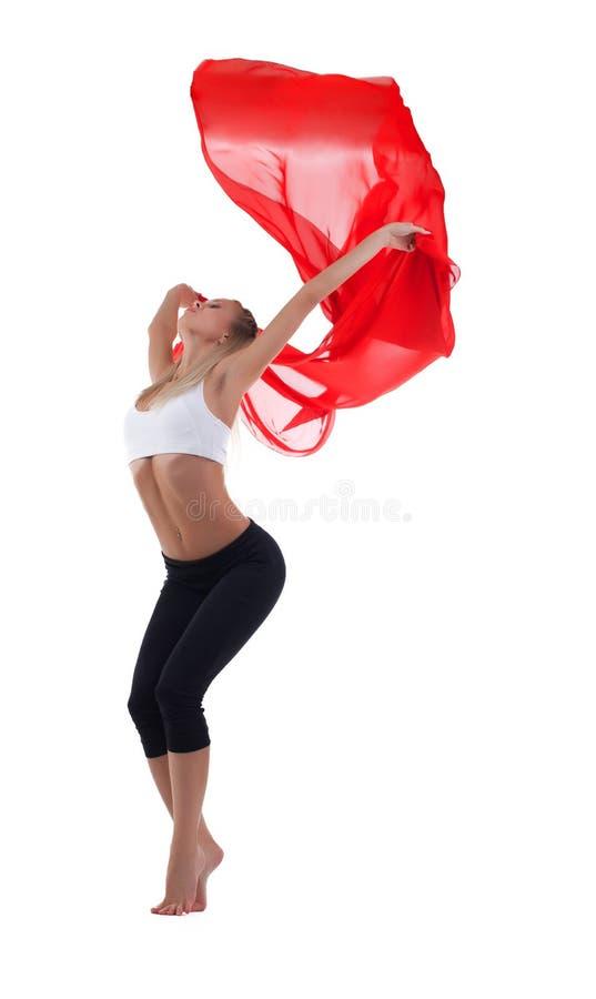 Ung blond kvinnadans med rött flygtyg royaltyfria bilder