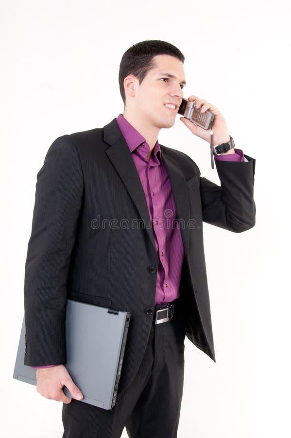 Ung bussinesman med telefonen royaltyfri foto