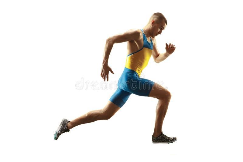 Ung caucasian man som kör eller joggar som isoleras på vit studiobakgrund royaltyfria foton