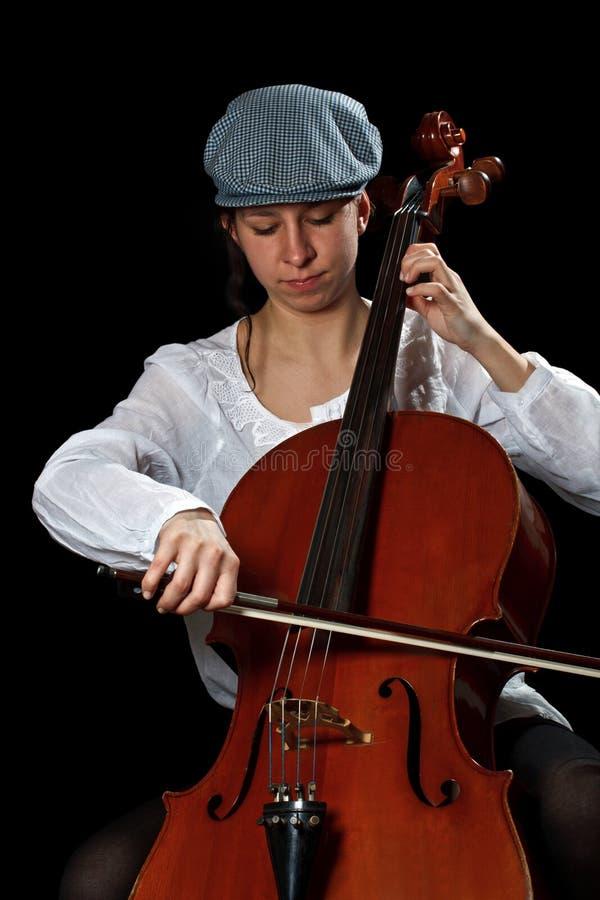 Ung cellist royaltyfri foto