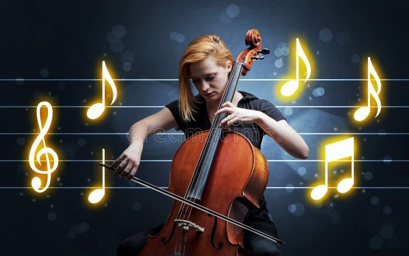 Ung cellist med musikarket royaltyfria bilder