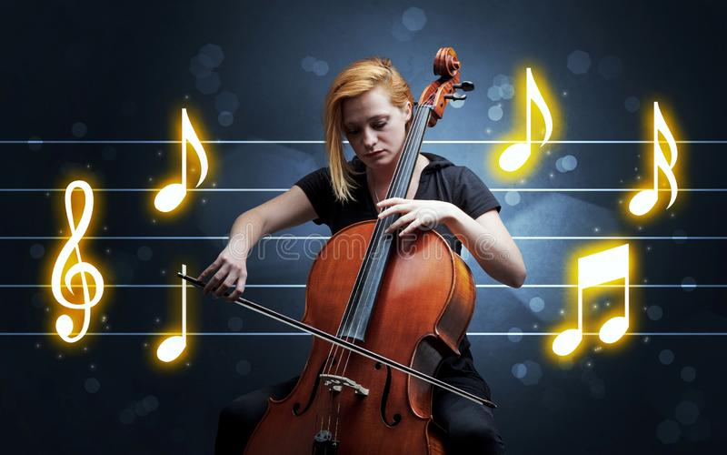 Ung cellist med musikarket royaltyfri foto